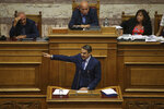 New Democracy party leader Kyriakos Mitsotakis addresses lawmakers during a parliamentary session where he submitted a motion of no confidence against Prime Minister Alexis Tsipras, in Athens, on Thursday, June 14, 2018. The head of Greece's main opposition party submitted a motion for a no-confidence vote in the government, objecting to a deal reached between the prime ministers of Greece and Macedonia to settle a decades-old dispute over Macedonia's name. (AP Photo/Petros Giannakouris)