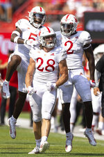 From left, Nebraska defenders Cam Taylor-Britt, Luke Reimer and Caleb Tannor celebrate after stopping a fourth down conversion attempt by Buffalo during the first half of an NCAA college football game Saturday, Sept. 11, 2021, at Memorial Stadium in Lincoln, Neb. (AP Photo/Rebecca S. Gratz)