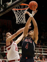 Arizona center Chase Jeter (4) shoots against Stanford center Josh Sharma (20) during the first half of an NCAA college basketball game in Stanford, Calif., Wednesday, Jan. 9, 2019. (AP Photo/Jeff Chiu)