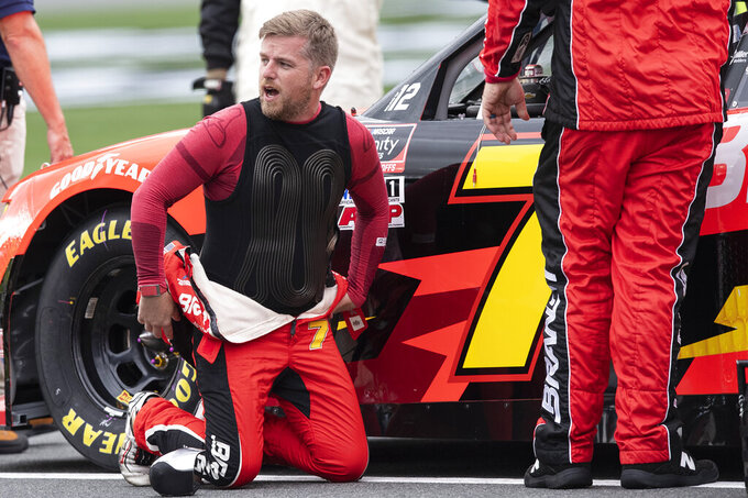 NASCAR Xfinity Series driver Justin Allgaier (7) adjusts his race suit prior to the NASCAR Xfinity auto race at the Charlotte Motor Speedway Saturday, Oct. 9, 2021, in Concord, N.C. (AP Photo/Matt Kelley)