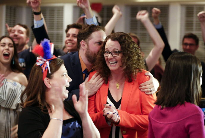 Democratic 2nd District House candidate Kara Eastman is hugged by her campaign manager Ben Onkka, in Omaha, Neb., Tuesday, May 15, 2018, as she holds a slim lead over Brad Ashford in the primary election. Omaha-area voters are set to pick a Democratic nominee Tuesday who will challenge U.S. Rep. Don Bacon, R-Neb., after the congressman claimed the seat from Democrats two years ago. (AP Photo/Nati Harnik)