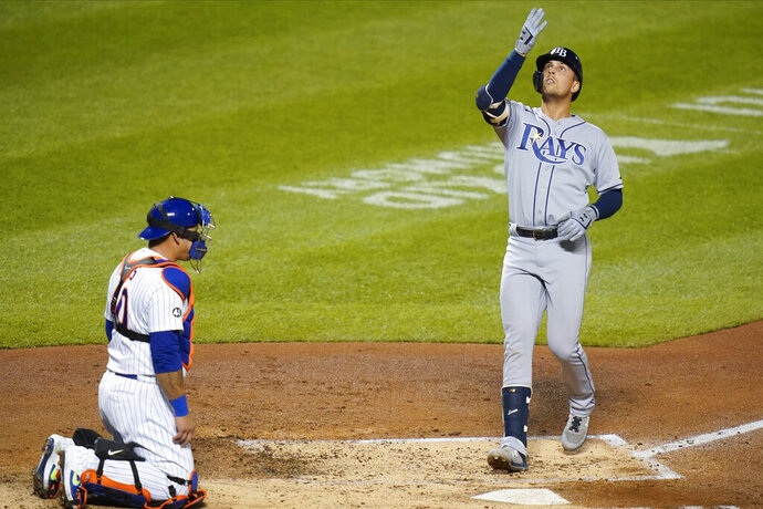 Tampa Bay Rays' Brandon Lowe celebrates as he reaches home plate after hitting a home run as New York Mets catcher Wilson Ramos, left, watches during the fourth inning of a baseball game Monday, Sept. 21, 2020, in New York. (AP Photo/Frank Franklin II)