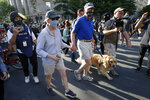 Sen. Elizabeth Warren, D-Mass., walks with her husband Bruce Mann and dog Bailey as demonstrators gather to protest the death of George Floyd, Tuesday, June 2, 2020, near the White House in Washington. Floyd died after being restrained by Minneapolis police officers. (AP Photo/Alex Brandon)