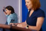 Commerce Secretary Gina Raimondo, left, accompanied by White House press secretary Jen Psaki, right, departs a press briefing in the briefing room of the White House in Washington, Thursday, July 22, 2021. (AP Photo/Andrew Harnik)