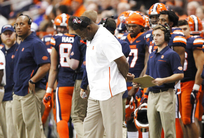 Syracuse coach Dino Babers looks down in the final minutes of the team's NCAA college football game against Pittsburgh in Syracuse, N.Y., Friday, Oct. 18, 2019. Pittsburgh won 27-20. (AP Photo/Nick Lisi)