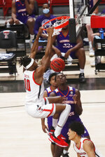 Texas Tech forward Tyreek Smith dunks during the first half of the team's NCAA college basketball game against Northwestern State, Wednesday, Nov. 25, 2020, in Lubbock, Texas. (AP Photo/Mark Rogers)