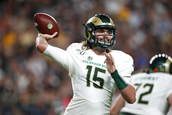 Colorado State quarterback Collin Hill throws a pass against Colorado in the first quarter of an NCAA college football game Friday, Aug. 30, 2019, in Denver. (AP Photo/David Zalubowski)