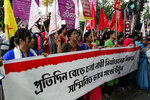 Activists demanding justice in the case of a veterinarian who was gang-raped and killed last week shout slogans during a protest in Kolkata, India, Thursday, Dec. 5, 2019. According to the most recent available official crime records, police registered 33,658 cases of rape in India in 2017 - an average of more than 90 every day. But the real figure is believed to be far higher as many women in India don't report cases to police due to fear. Banner reads,