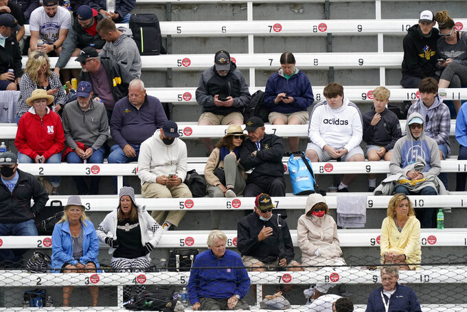 Fans watch during the final practice session for the Indianapolis 500 auto race at Indianapolis Motor Speedway, Friday, May 28, 2021, in Indianapolis. (AP Photo/Darron Cummings)