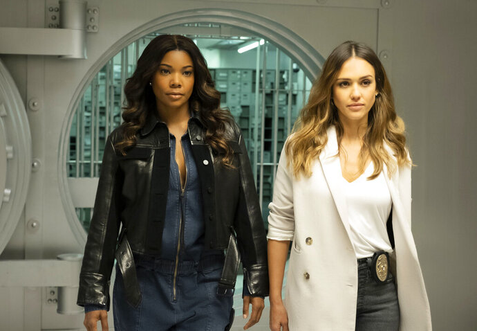 This image released by FOX hows Gabrielle Union, left, and Jessica Alba in a scene from