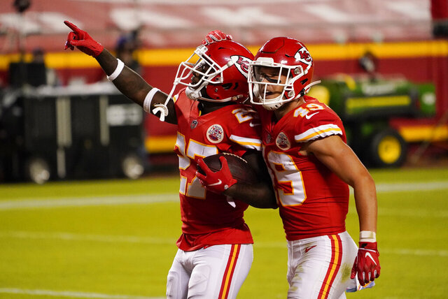 Kansas City Chiefs cornerback Rashad Fenton (27) celebrates with teammate Daniel Sorensen (49) after intercepting a pass during the second half of an NFL football game against the New England Patriots, Monday, Oct. 5, 2020, in Kansas City. (AP Photo/Jeff Roberson)