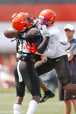 Cleveland Browns defensive back Robert Jackson (34) breaks up a pass intended for wide receiver Antonio Callaway (11) during practice at the NFL football team's training facility Monday, Aug. 5, 2019, in Berea, Ohio. (AP Photo/Ron Schwane)