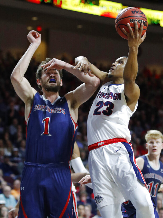 Gonzaga's Zach Norvell Jr. (23) shoots around St. Mary's Jordan Hunter during the first half of an NCAA college basketball game for the West Coast Conference men's tournament title, Tuesday, March 12, 2019, in Las Vegas. (AP Photo/John Locher)