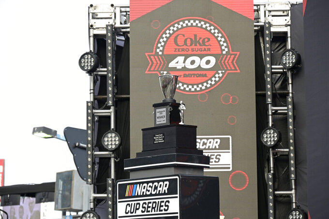A custom trophy commemorating Wendell Scott's historic 1963 victory is viewed on a stand before a NASCAR Cup Series auto race at Daytona International Speedway, Saturday, Aug. 28, 2021, in Daytona Beach, Fla. Scott was the only Black driver to win a race at NASCAR's top level.(AP Photo/Phelan M. Ebenhack)