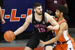 Penn State forward Trent Buttrick (15) controls the ball as Illinois guard Jacob Grandison defends during the first half of an NCAA college basketball game Tuesday, Jan. 19, 2021, in Champaign, Ill. (AP Photo/Holly Hart)