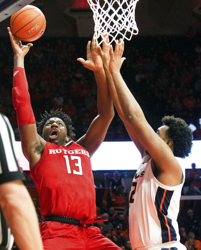 Rutgers forward Shaq Carter (13) is guarded by Illinois center Adonis De La Rosa (12) during the first half of an NCAA college basketball game in Champaign, Ill., Saturday, Feb. 9, 2019. (AP Photo/Robin Scholz)