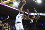 UCLA forward Cody Riley (2) tips in the ball over Colorado forward Evan Battey (21) during the second half of an NCAA college basketball game, Thursday, Jan. 30, 2020, in Los Angeles. UCLA won 72-68. (AP Photo/Michael Owen Baker)