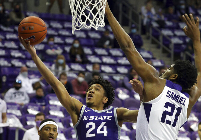 FILE - Kansas State guard Nijel Pack (24) goes up for a shot against TCU center Kevin Samuel (21) in the second half of an NCAA mens college basketball game in Fort Worth, Texas, in this Saturday, Feb. 20, 2021, file photo. They return most of their players from last season, including leading scorers Nijel Pack and Mike McGuirl, and they brought in plenty of help. (AP Photo/Richard W. Rodriguez, File)