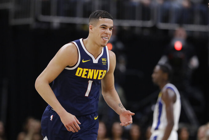 Denver Nuggets' Michael Porter Jr. reacts during the second half of the team's NBA basketball game against the Indiana Pacers, Thursday, Jan. 2, 2020, in Indianapolis. Denver won 124-116. (AP Photo/Darron Cummings)