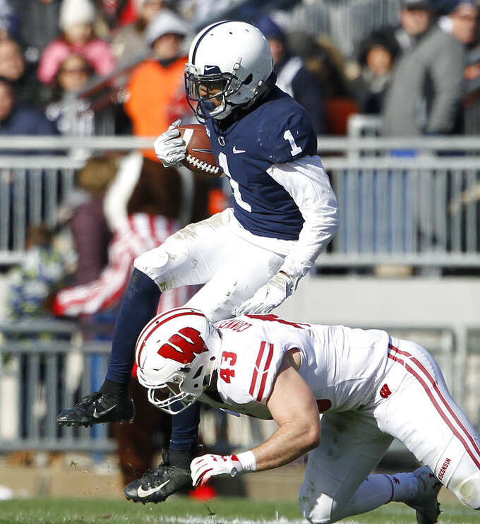 Penn State's KJ Hamler (1) gets hit by Wisconsin's Ryan Connelly (43) after a catch during the first half of an NCAA college football game in State College, Pa., Saturday, Nov. 10, 2018. (AP Photo/Chris Knight)