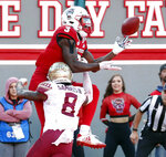 North Carolina State's Kelvin Harmon (3) hauls in a pass for a touchdown against Florida State's Stanford Samuels III (8) during the first half of an NCAA college football game in Raleigh, N.C., Saturday, Nov. 3, 2018. (AP Photo/Chris Seward)