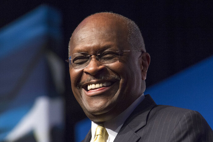 FILE - In this June 20, 2014, file photo, Herman Cain, CEO, The New Voice, speaks during Faith and Freedom Coalition's Road to Majority event in Washington. Cain is being treated for the coronavirus at an Atlanta-area hospital. That's according to a statement posted on his Twitter account Thursday, July 2, 2020. (AP Photo/Molly Riley, File)
