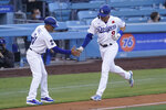 Los Angeles Dodgers' Gavin Lux (9) gets a high-five from third base coach Dino Ebel (91) as he runs the bases after hitting a home run during the second inning of a baseball game against the St. Louis Cardinals Monday, May 31, 2021, in Los Angeles. (AP Photo/Ashley Landis)