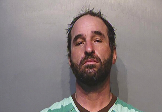 This photo provided by Polk County (Iowa) Jail shows Douglas Jensen.  Authorities have arrested Jensen from Des Moines, Iowa, who allegedly took part in the riot at the U.S. Capitol building by supporters of President Donald Trump. Police Sgt. Paul Parizek said Saturday, Jan. 9, 2021, that officers assisted the FBI in arresting Jensen on Friday night at his home. (Polk County (Iowa) Jail via AP)