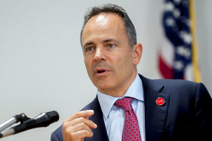 FILE - In this Aug. 16, 2019, file photo, Kentucky Republican Gov. Matt Bevin speaks during a news conference at Glasgow City Hall in Glasgow, Ky. Bevin said Tuesday, Oct. 1, 2019, that he'll push to exempt the retirement income of military veterans from state taxation as part of a comprehensive tax package that the Republican incumbent vowed to pursue if he wins a second term in November. (Bac Totrong/Daily News via AP, File)