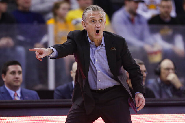 Illinois-Chicago coach Steve McClain reacts during in the first half of the team's NCAA college basketball game against Northern Kentucky for the Horizon League men's tournament championship in Indianapolis, Tuesday, March 10, 2020. (AP Photo/Michael Conroy)