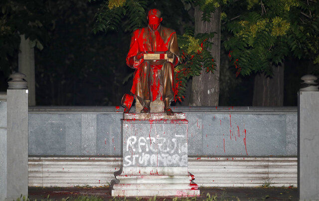 CORRECTS CIRCUMSTANCES IN WHICH STATUE WAS VANDALIZED. Red paint and words in Italian reading ''racist