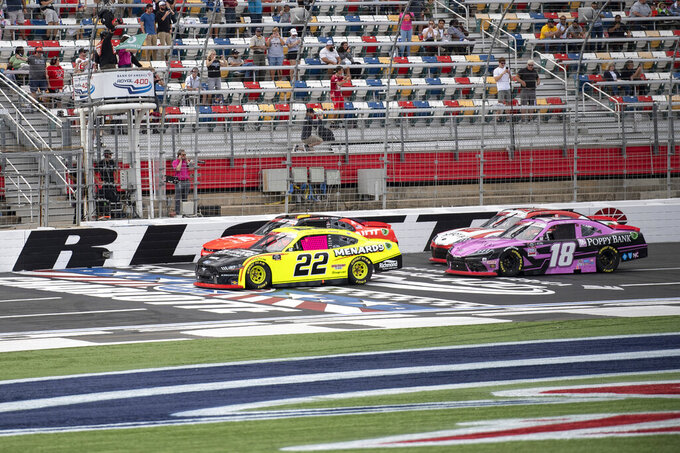 NASCAR Xfinity Series driver Austin Cindric (22) leads a pack of cars to the green flag during the NASCAR Xfinity auto racing race at the Charlotte Motor Speedway Saturday, Oct. 9, 2021, in Concord, N.C. (AP Photo/Matt Kelley)