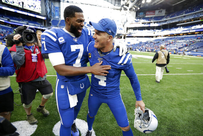 Indianapolis Colts quarterback Jacoby Brissett (7) reacts with kicker Adam Vinatieri following an NFL football game against the Denver Broncos, Sunday, Oct. 27, 2019, in Indianapolis. (AP Photo/Michael Conroy)