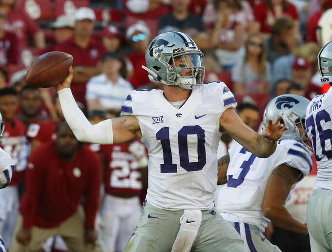 Kansas State quarterback Skylar Thompson (10) throws in the second half of an NCAA college football game against Oklahoma in Norman, Okla., Saturday, Oct. 27, 2018. (AP Photo/Sue Ogrocki)