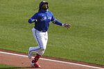 Toronto Blue Jays Vladimir Guerrero Jr. celebrates his home run against Baltimore Orioles pitcher Keegan Akin during the third inning of a baseball game, Sunday, Sept. 27, 2020, in Buffalo, N.Y. (AP Photo/Jeffrey T. Barnes)