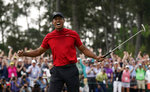 FILE - In this April 14, 2019, file photo, Tiger Woods reacts as he wins the Masters golf tournament in Augusta, Ga. His victory raises hope that he can pursue the record 18 majors won by Jack Nicklaus. (AP Photo/David J. Phillip, File)