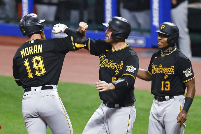 Pittsburgh Pirates' Colin Moran (19) celebrates with Jacob Stallings (58) and Ke'Bryan Hayes (13) after hitting a three-run home run off Cleveland Indians pitcher Aaron Civale during the fourth inning of a baseball game Saturday, Sept. 26, 2020, in Cleveland. (AP Photo/Ron Schwane)