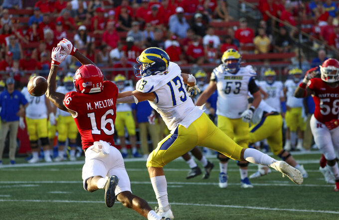 Rutgers defensive back Max Melton (16) makes a play on a pass intended for Delaware wide receiver Brett Buckman (13) during the second half of an NCAA college football game, Saturday, Sept. 18, 2021, in Piscataway, N.J. Rutgers won, 45-13. (Andrew Mills/NJ Advance Media via AP)
