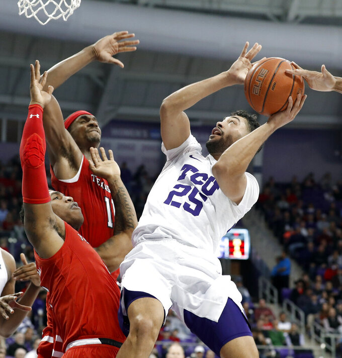 TCU guard Alex Robinson (25) struggles to get a shot off as Texas Tech Deshawn Corprew, bottom left, and Tariq Owens (11) defend in the second half of an NCAA college basketball game in Fort Worth, Texas, Saturday, March 2, 2019. (AP Photo/Tony Gutierrez)