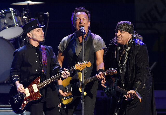 "FILE - In this March 15, 2016 file photo, Bruce Springsteen, center, performs with Nils Lofgren, left, and Steven Van Zandt of the E Street Band during their concert at the Los Angeles Sports Arena in Los Angeles. Springsteen will release a new rock album he recorded live in his New Jersey home studio with the E Street Band. The Boss said Thursday, Sept. 10, 2020, the album is called ""Letter to You"" and he and the band recorded it in just five days. It will be released on Oct. 23. (Photo by Chris Pizzello/Invision/AP, File)"