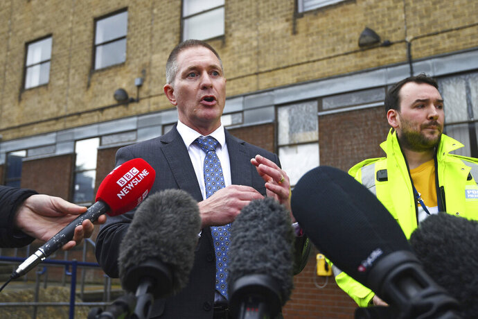Detective Chief Inspector Martin Pasmore speaks to the media during a press conference at Grays Police Station in Essex, England after the bodies of 39 people were found inside a lorry in the Waterglade Industrial Park during the early hours of Wednesday morning. Saturday Oct. 26, 2019. (Victoria Jones/PA via AP)