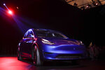 The Tesla Model Y is unveiled at Tesla's design studio Thursday, March 14, 2019, in Hawthorne, Calif. The Model Y may be Tesla's most important product yet as it attempts to expand into the mainstream and generate enough cash to repay massive debts that threaten to topple the Palo Alto, Calif., company. (AP Photo/Jae C. Hong)