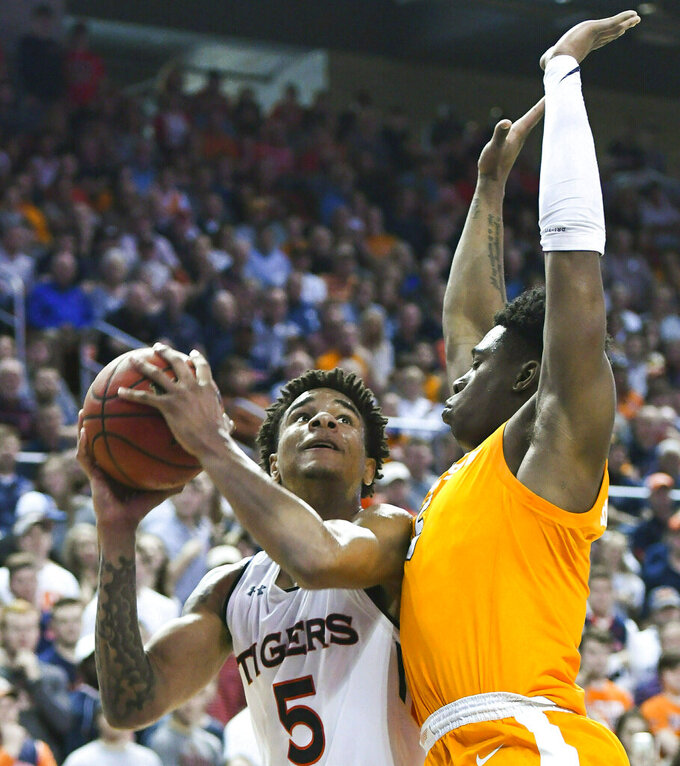Auburn forward Chuma Okeke (5) shoots over Tennessee guard Admiral Schofield (5) during the second half of an NCAA college basketball game Saturday, March 9, 2019, in Auburn, Ala. (AP Photo/Julie Bennett)