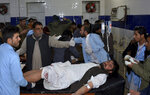 An injured victim of mosque bombing, is treated at a hospital in Quetta, Pakistan, Friday, Jan. 10, 2020. A powerful explosion ripped through a mosque in southwest Pakistan during Friday evening prayers, killing a senior police officer with some civilians and wounded other worshipers, police said. (AP Photo/Arshad Butt)