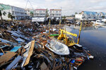 FILE - In this Oct. 11, 2018 file photo, a boat sits amidst debris in the aftermath of Hurricane Michael in Mexico Beach, Fla. The tropical weather that turned into monster Hurricane Michael began as a relatively humble storm before rapidly blossoming into the most powerful cyclone ever to hit the Florida Panhandle, causing wrenching scenes of widespread destruction. (AP Photo/Gerald Herbert, File)
