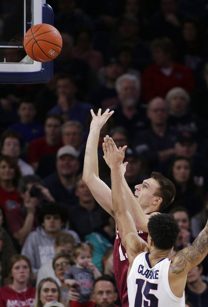 Santa Clara forward Josip Vrankic, back, shoots while defended by Gonzaga forward Brandon Clarke (15) during the first half of an NCAA college basketball game in Spokane, Wash., Saturday, Jan. 5, 2019. (AP Photo/Young Kwak)