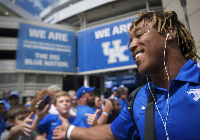 Kentucky running back Benny Snell Jr. greets fans before an NCAA college football game against Central Michigan in Lexington, Kentucky, Ky., Saturday, Sept. 1, 2018. (AP Photo/Bryan Woolston)