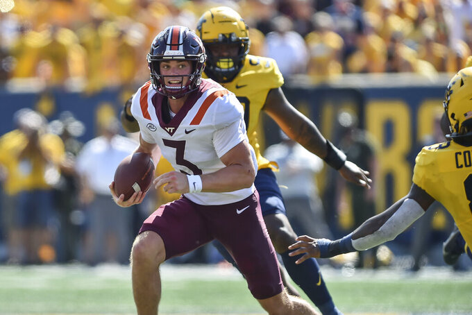 Virginia Tech Hokies Braxton Burmeister (3) rushes the ball against West Virginia during the second half of an NCAA college football game in Morgantown, W.Va., Saturday, Sep. 18, 2021. (AP Photo/William Wotring)