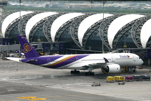 FILE - In this May 11, 2018, file photo, a Thai Airways jet parks at Suvarnabhumi Airport in Bangkok, Thailand. Thailand's government spokeswoman says Prime Minister Prayuth Chan-ocha has endorsed a plan for flag carrier Thai Airways International to file a rehabilitation plan with the country's Central Bankruptcy Court. (AP Photo/Sakchai Lalit, File)