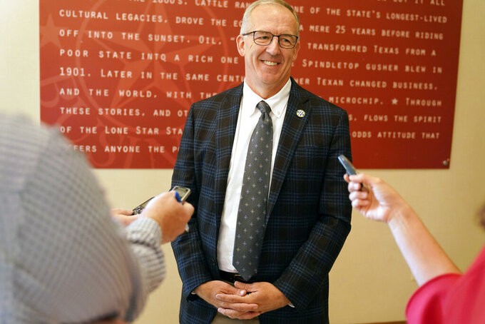 Greg Sankey, commissioner of the Southeastern Conference, smiles as he speaks to reporters after the College Football Playoff meeting Tuesday, June 22, 2021, in Grapevine, Texas. The CFP met to discuss a proposed plan to expand the postseason format from four to 12 teams. (AP Photo/LM Otero)